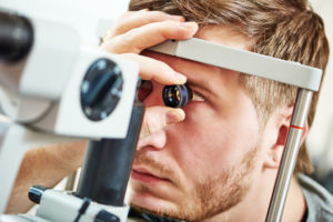 Slit lamp and retinal exam with magnifying wide-field viewing lens